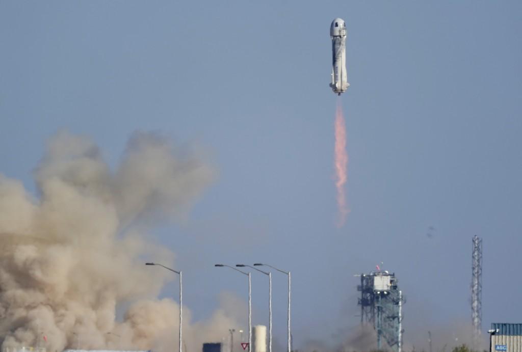 Blue Origin's New Shepard rocket launches carrying passengers William Shatner, Chris Boshuizen, Audrey Powers and Glen de Vries from its spaceport nea...