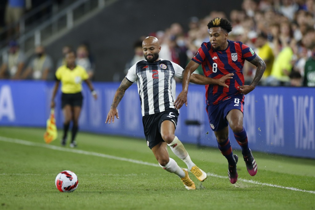 Costa Rica's Ricardo Blanco, left, and United States' Weston McKennie chase the ball during the first half of a World Cup qualifying soccer match Wedn...