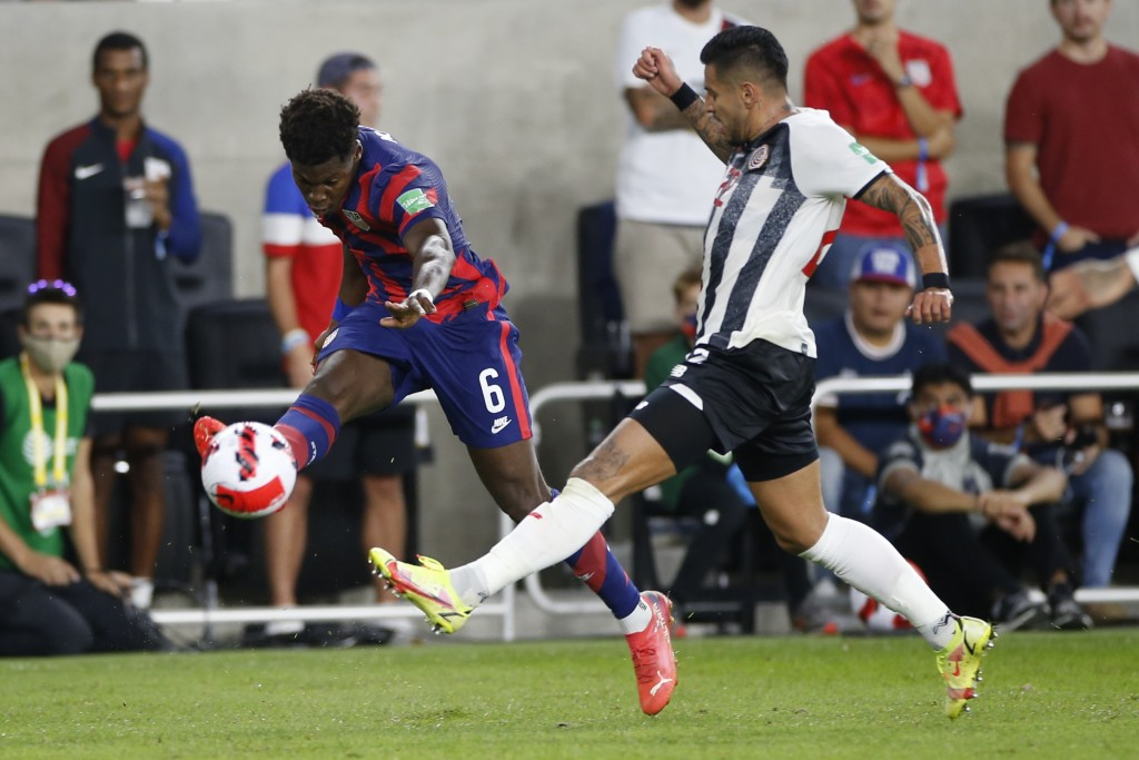 United States' Yunus Musah, left, kicks the ball past Costa Rica's Ronald Matarrita during the first half of a World Cup qualifying soccer match Wedne...