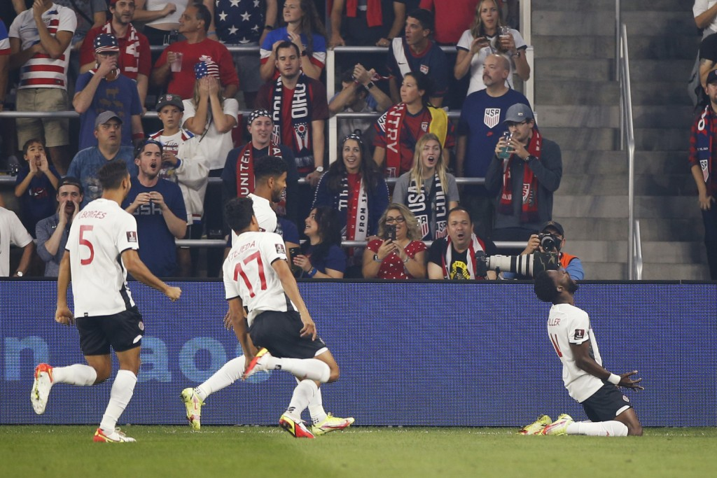 Costa Rica's Keysher Fuller, right, celebrates his goal against the United States with teammates during the first half of a World Cup qualifying socce...