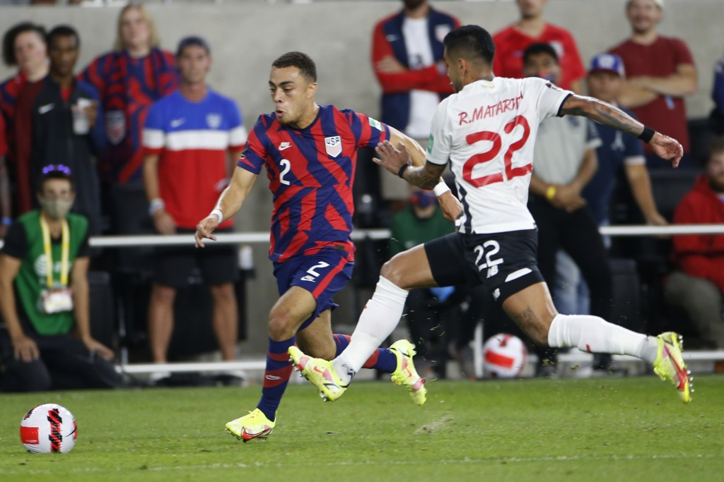United States' Sergino Dest, left, dribbles the ball upfield as Costa Rica's Ronald Matarrita defends during the first half of a World Cup qualifying ...