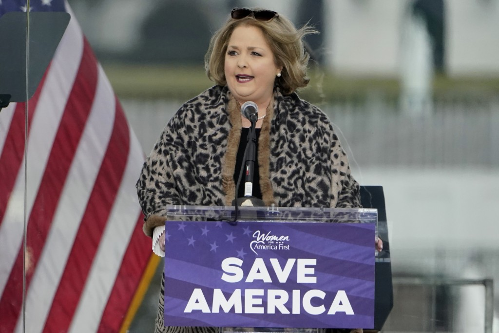 FILE - In this Jan. 6, 2021 file photo Amy Kremer, founder and chair of Women for America First, speaks in Washington, at a rally in support of Presid...