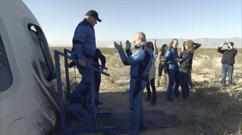 In this image provided by Blue Origin, William Shatner exits the Blue Origin capsule as he is greeted by Jeff Bezos near Van Horn, Texas, Wednesday, O...