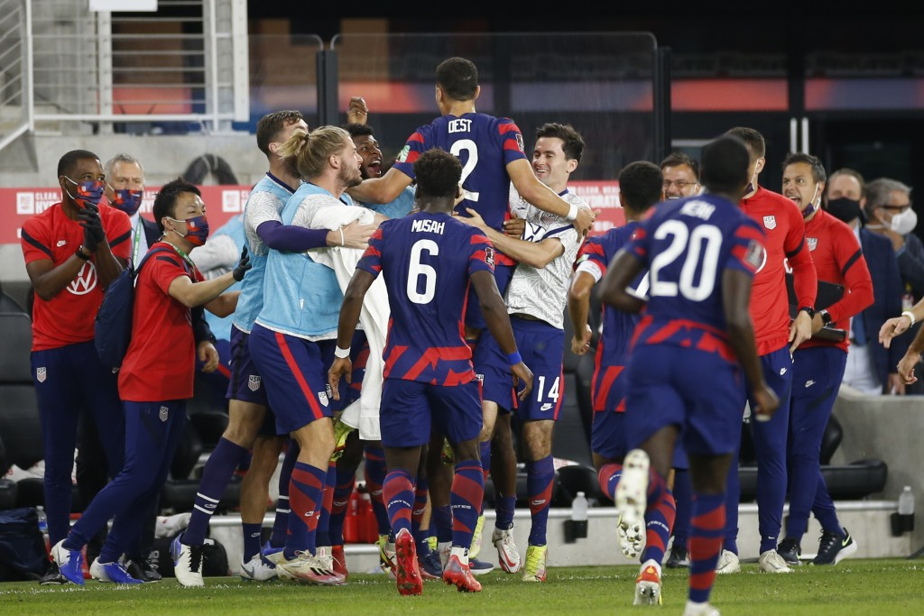 United States' Sergino Dest (2) celebrates his goal against Costa Rica with teammates during the first half of a World Cup qualifying soccer match Wed...