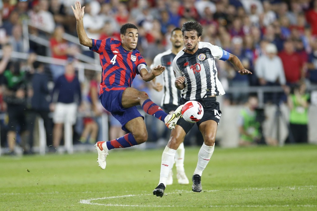 United States' Tyler Adams, left, and Costa Rica's Bryan Ruiz chase the ball during the second half of a World Cup qualifying soccer match Wednesday, ...