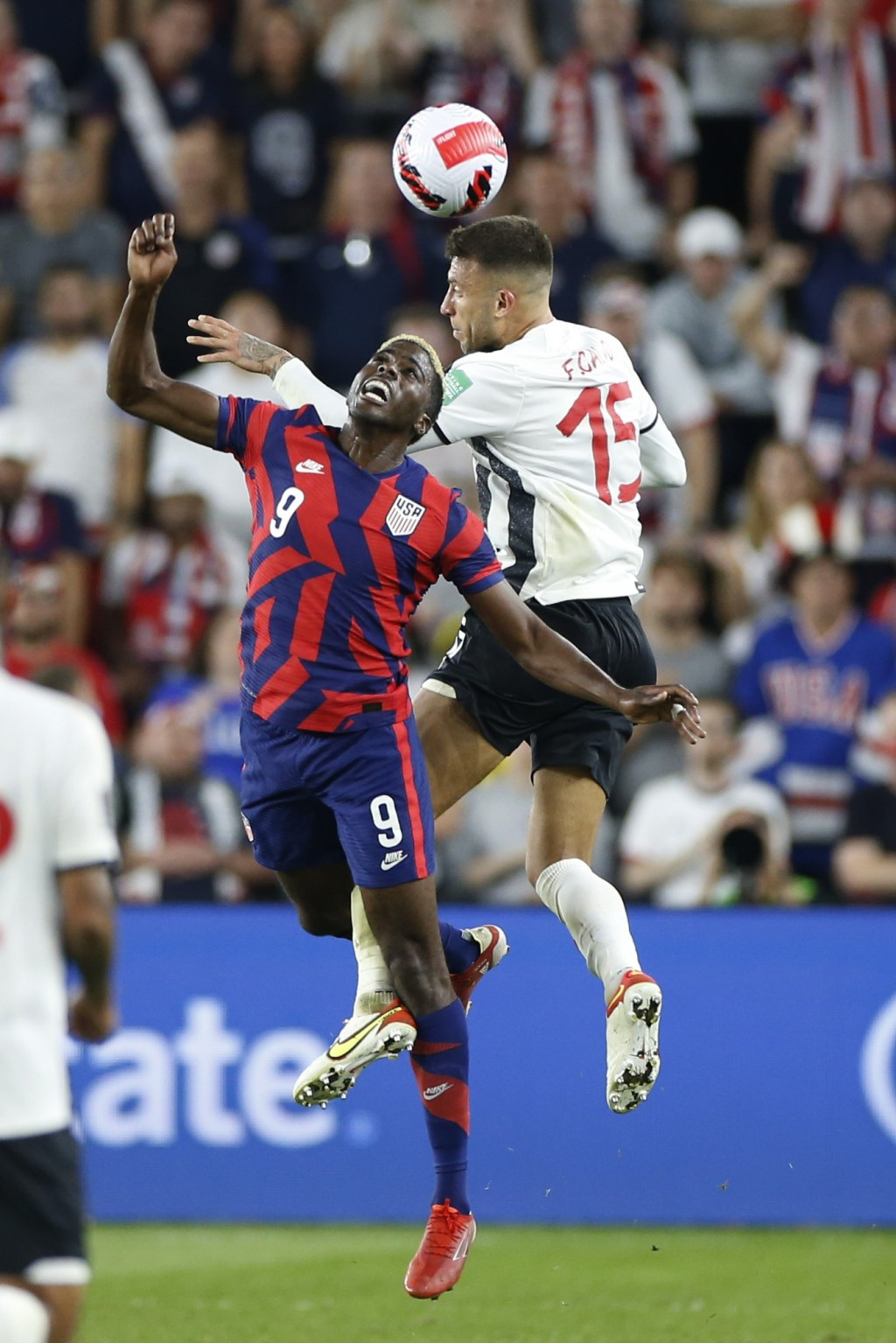 United States' Gyasi Zardes, left, and Costa Rica's Francisco Calvo jump for a head ball during the second half of a World Cup qualifying soccer match...
