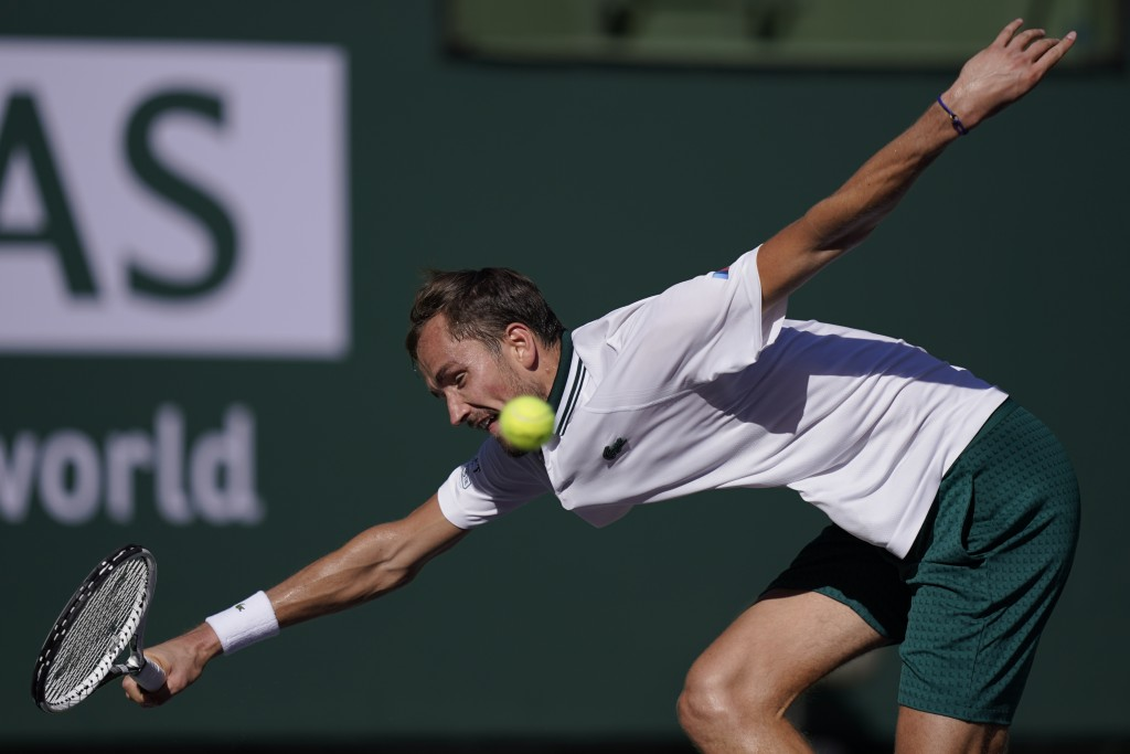 Daniil Medvedev, of Russia, returns a shot to Grigor Dimitrov, of Bulgaria, at the BNP Paribas Open tennis tournament Wednesday, Oct. 13, 2021, in Ind...