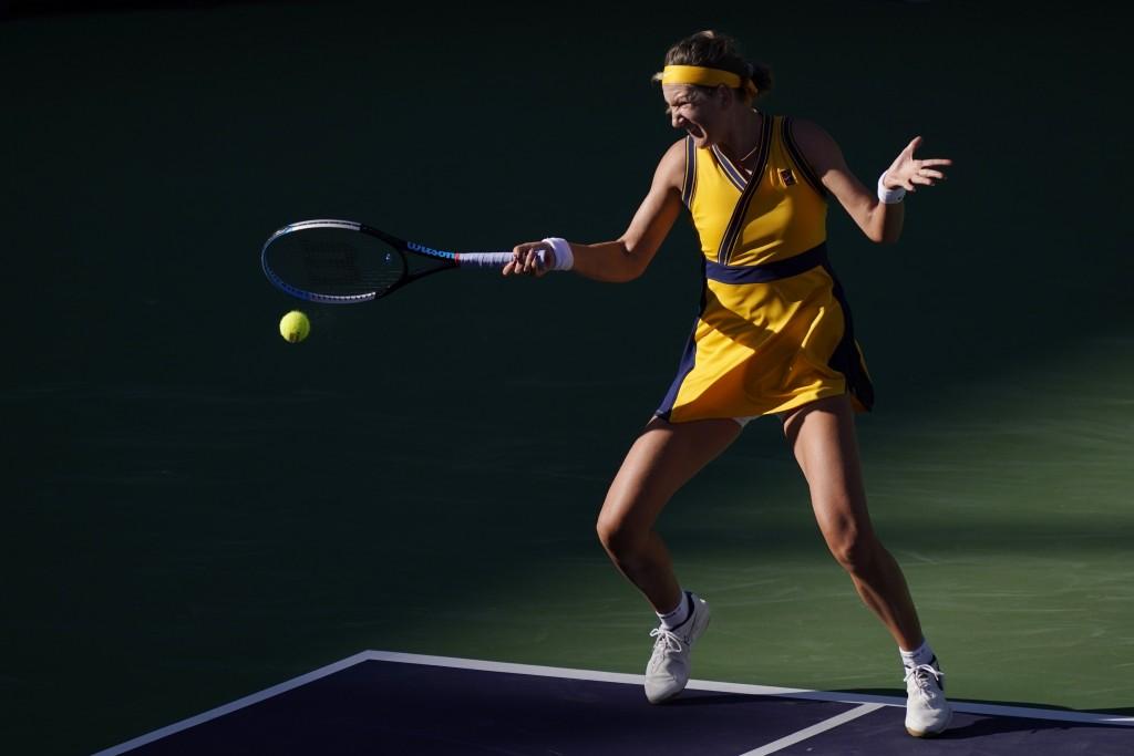 Victoria Azarenka, of Belarus, returns a shot to Jessica Pegula at the BNP Paribas Open tennis tournament Wednesday, Oct. 13, 2021, in Indian Wells, C...
