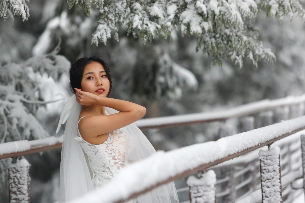 Photo of the Day: Taiwanese tourists go snow crazy
