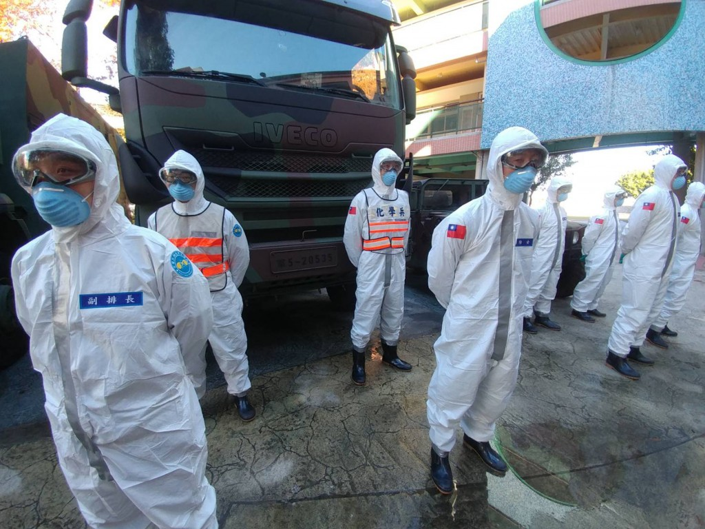33rd Chemical Warfare Group soldiers deployed to carry out disinfection of areas around Taoyuan General Hospital.