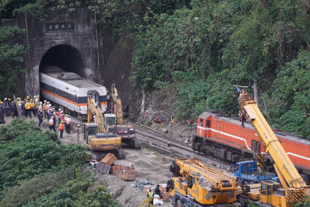 Train wreckage being removed on April 4