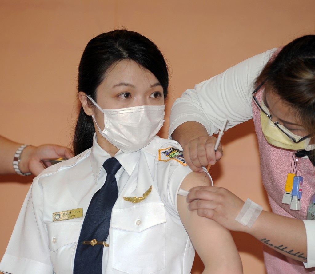 NIA officer receiving AstraZeneca vaccine on April 12.