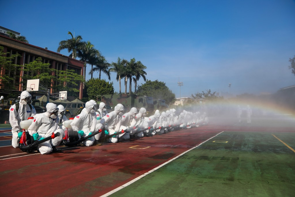 Chemical warfare soldiers disinfect Longshan Elementary School.