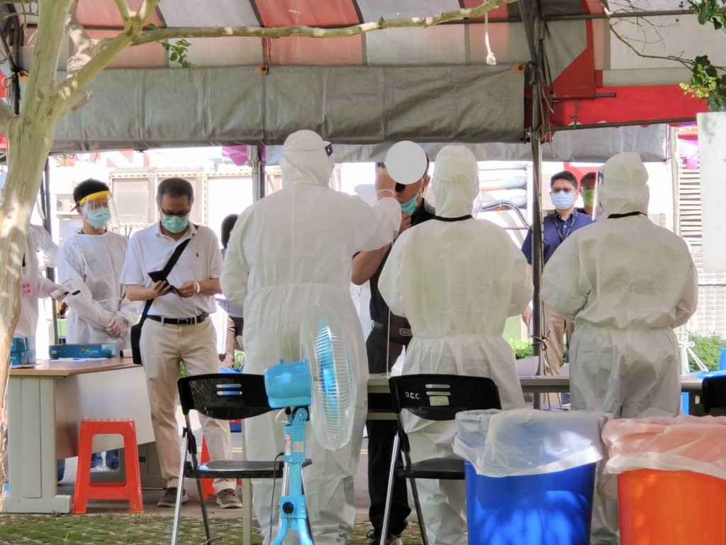 Virus testing for migrant workers at FITI Group in Miaoli County