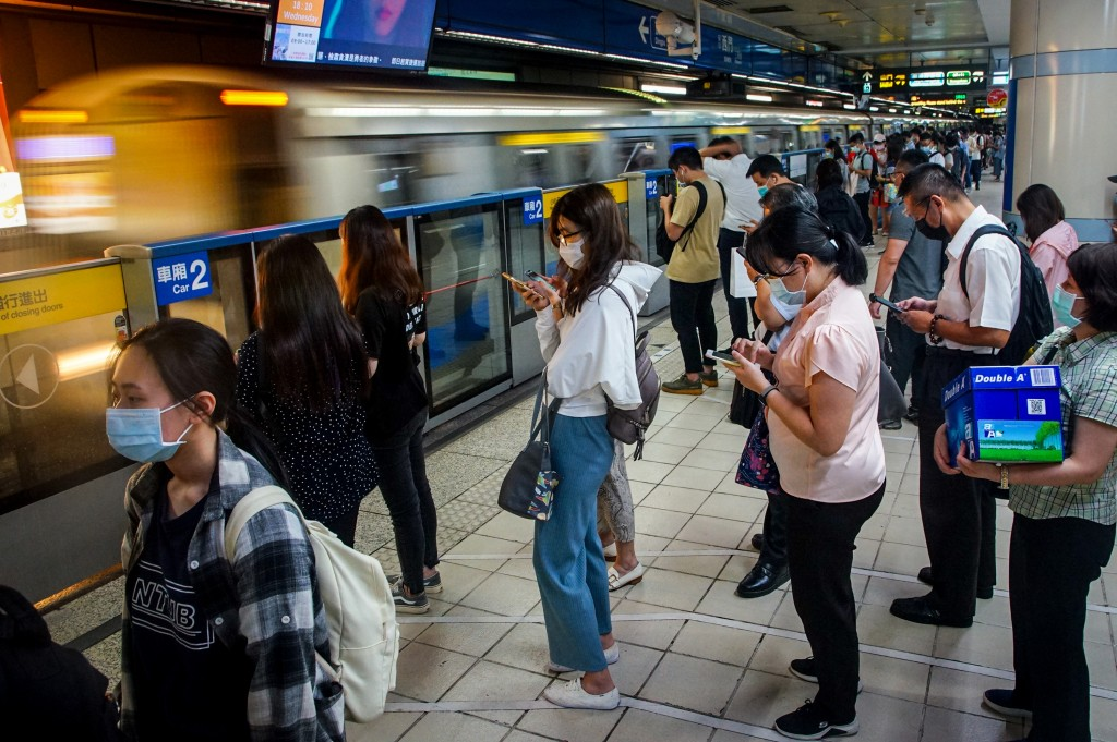 Passengers waiting to board MRT train on Aug. 18.