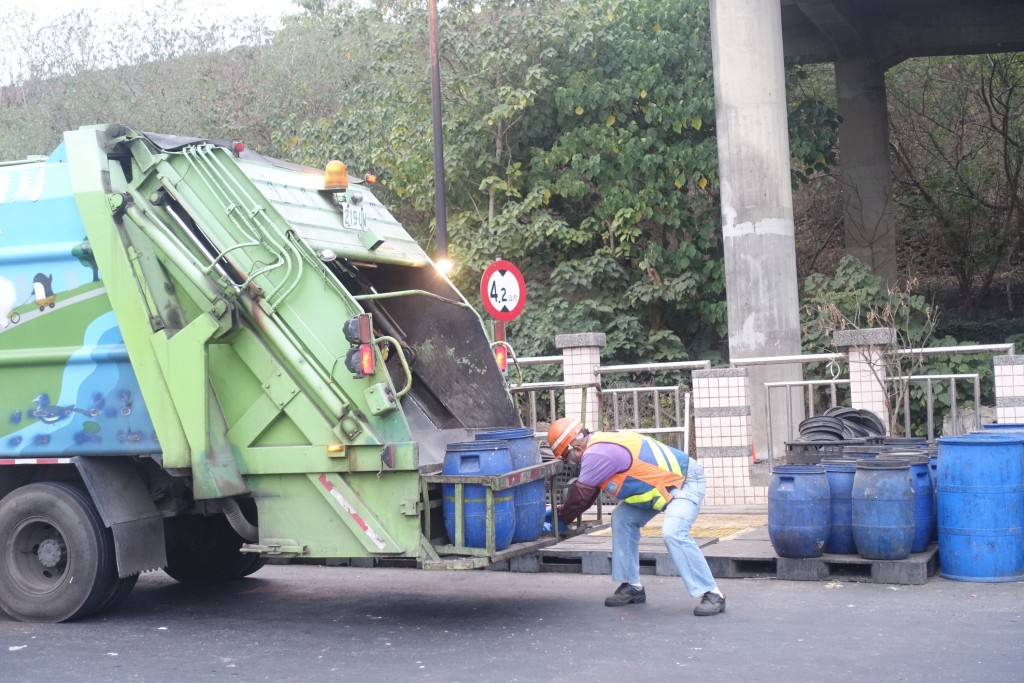 Food waste is loaded off the back of a garbage recycling truck in southern Taiwan.