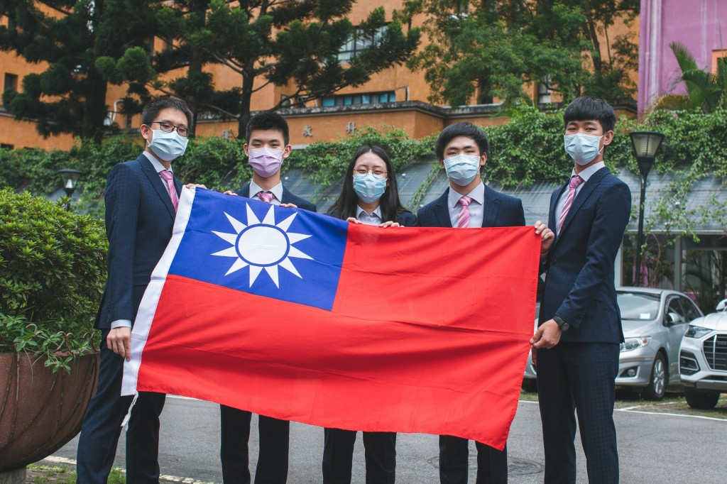 Taiwan's team stands proudly with the national flag after the competition.