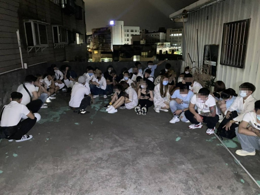 Vietnamese migrant workers attempting to hide on the roof of the restaurant. (Taoyuan City Police Department photo)