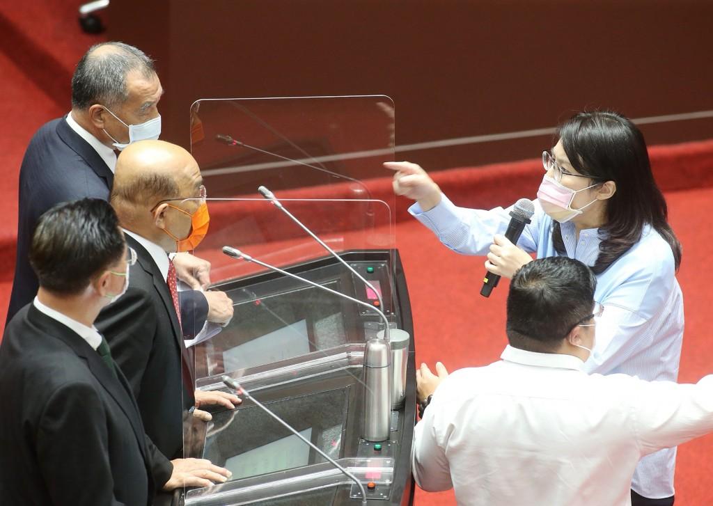 "Legislator Cheng Li-wun storms up to Premier Su Tseng-chang after he calls her ""shameless."""