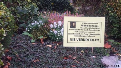 'Never convicted!!!': One of the signs placed at Wilhelm Koppe's gravesite