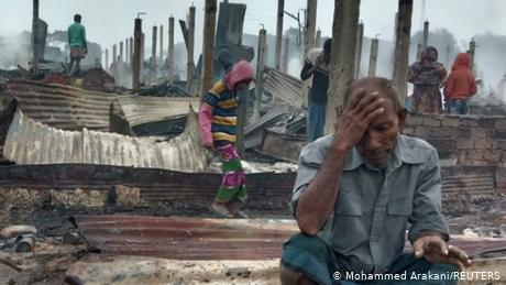 A Rohingya man reacts after a fire burned houses of the Nayapara refugee camp in Cox's Bazar, Bangladesh