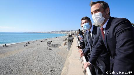 French Health Minister Oliver Veran (right) says the government is considering tougher measures