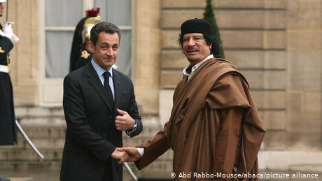 A photo from better times for Nicolas Sarkozy: Shaking hands with Libya's dictator  Muammar Gaddafi in 2007