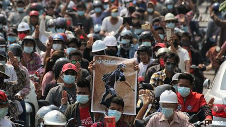 People attend a funeral for 'Angel,' a 19-year-old protester shot dead in Mandalay