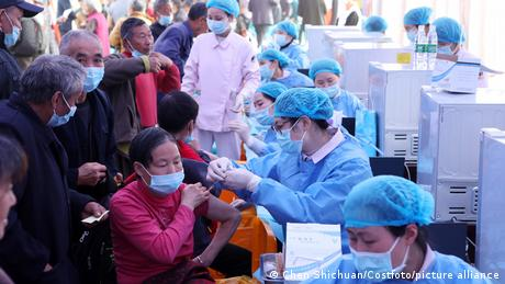 Different cities and institutions have deployed different tactics to reach China's vaccination goals