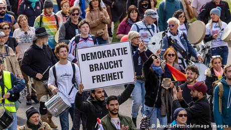 Members of the 'Querdenker' movement march in Stuttgart