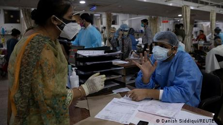 A relative of a COVID patient in New Delhi is turned away at a packed hospital