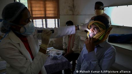 A man with a fungal infection is examined at a hospital in Hyderabad