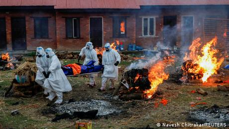 Bodies of COVID victims are cremated in Kathmandu