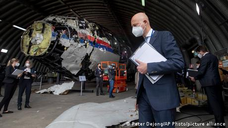 Presiding judge Hendrik Steenhuis and other trial judges and lawyers view the reconstructed wreckage of Malaysia Airlines Flight MH17, at the Gilze-Ri...