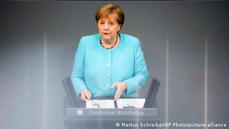 """Merkel called for """"cautious optimism"""" and said the pandemic is not yet over"""