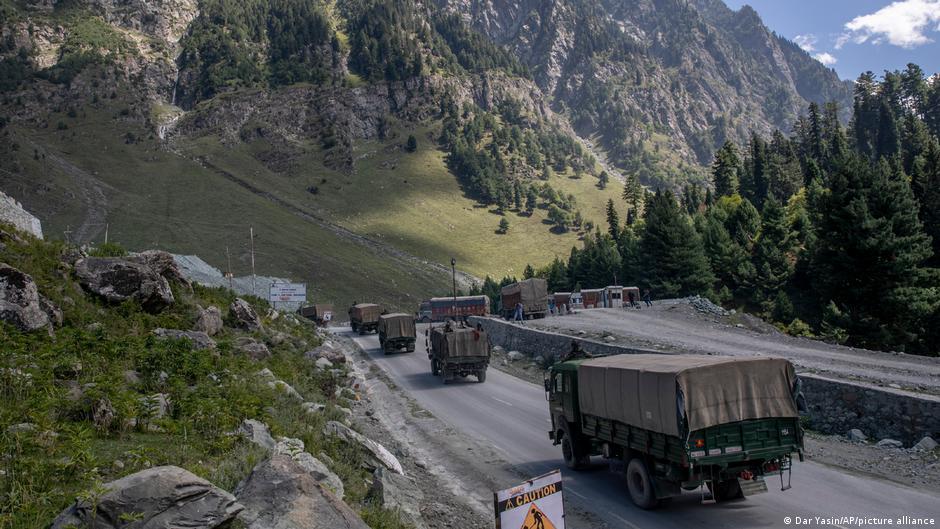 Military trucks roll along a mountainous road toward the Line of Actual Control (LAC) along the Sino-Indian border in the Himalayas.