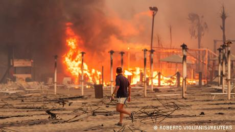 Firefighters on the Italian island of Sicily are battling dozens of wildfires, some of which ripped through beachside tourist areas