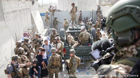 Soldiers tried to bring some order to the Kabul evacuations