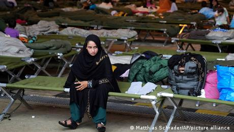 An Afghan girl sits in the transit area at the US Ramstein Air Base in Germany