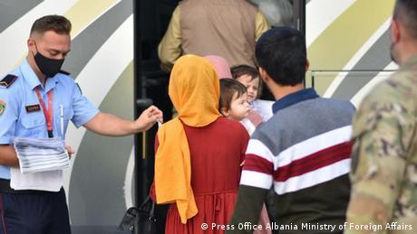 Afghan refugees arrive in Albania's capital Tirana on August 28, 2021