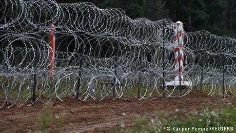 Poland built a wire fence on the border with Belarus to prevent migrants crossing