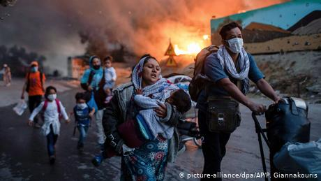 One year ago: Refugees flee the flames at the Moria camp