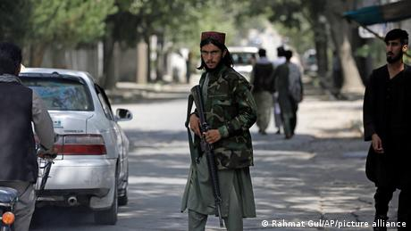 Rohullah Azizi and his driver were stopped by the Taliban at a checkpoint and shot dead