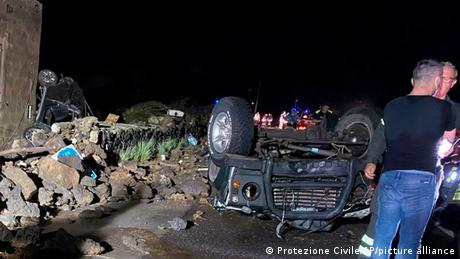 Two wrecked cars that were swiped by a tornado lay on a road in the Italian southern island of Pantelleria