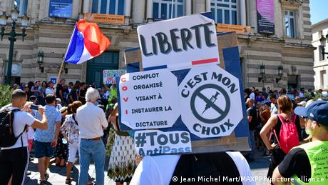 """Health workers joined opponents of a new coronavirus """"health pass"""" at weekly protests held across France over the rule"""