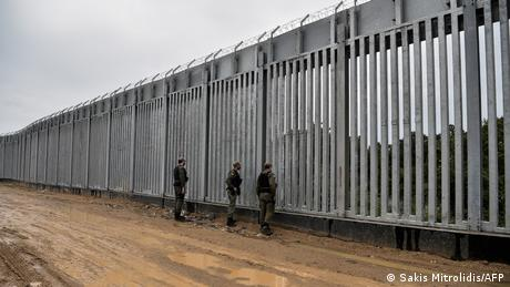 Greek border guards at the fence on the border with Turkey