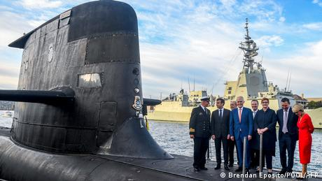 French President Emmanuel Macron and Australian Prime Minister Malcolm Turnbull standing on the deck of HMAS Waller, a Collins-class submarine operate...