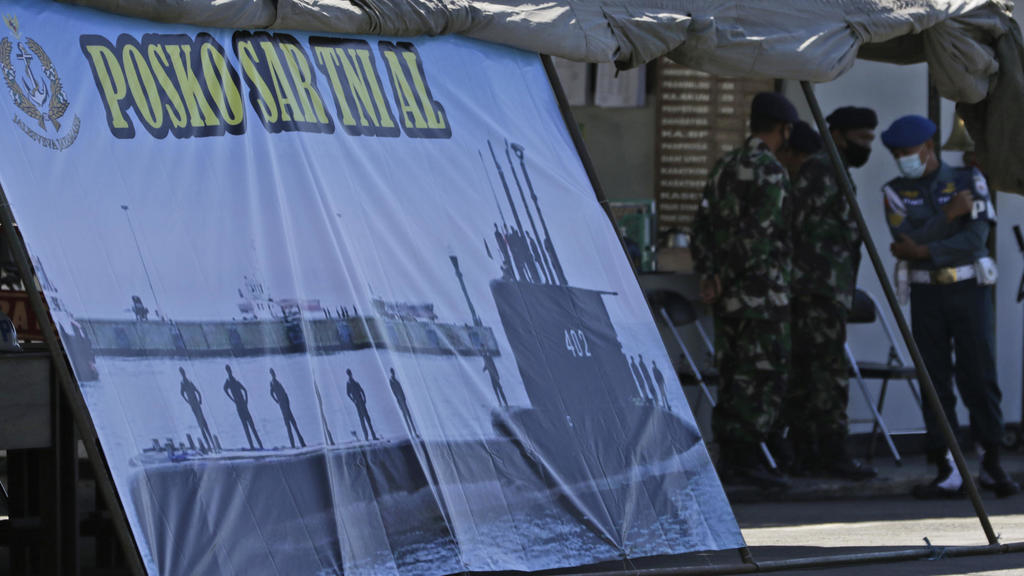 A picture of Indonesian Navy submarine KRI Nanggala that went missing is installed at a command tent set up at a naval base in Banyuwangi, East Java, ...