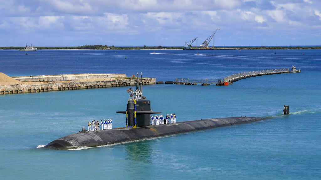 The Los Angeles-class nuclear-powered fast attack submarine USS Oklahoma City (SSN 723) at the US Naval Base in Guam, August 19, 2021.
