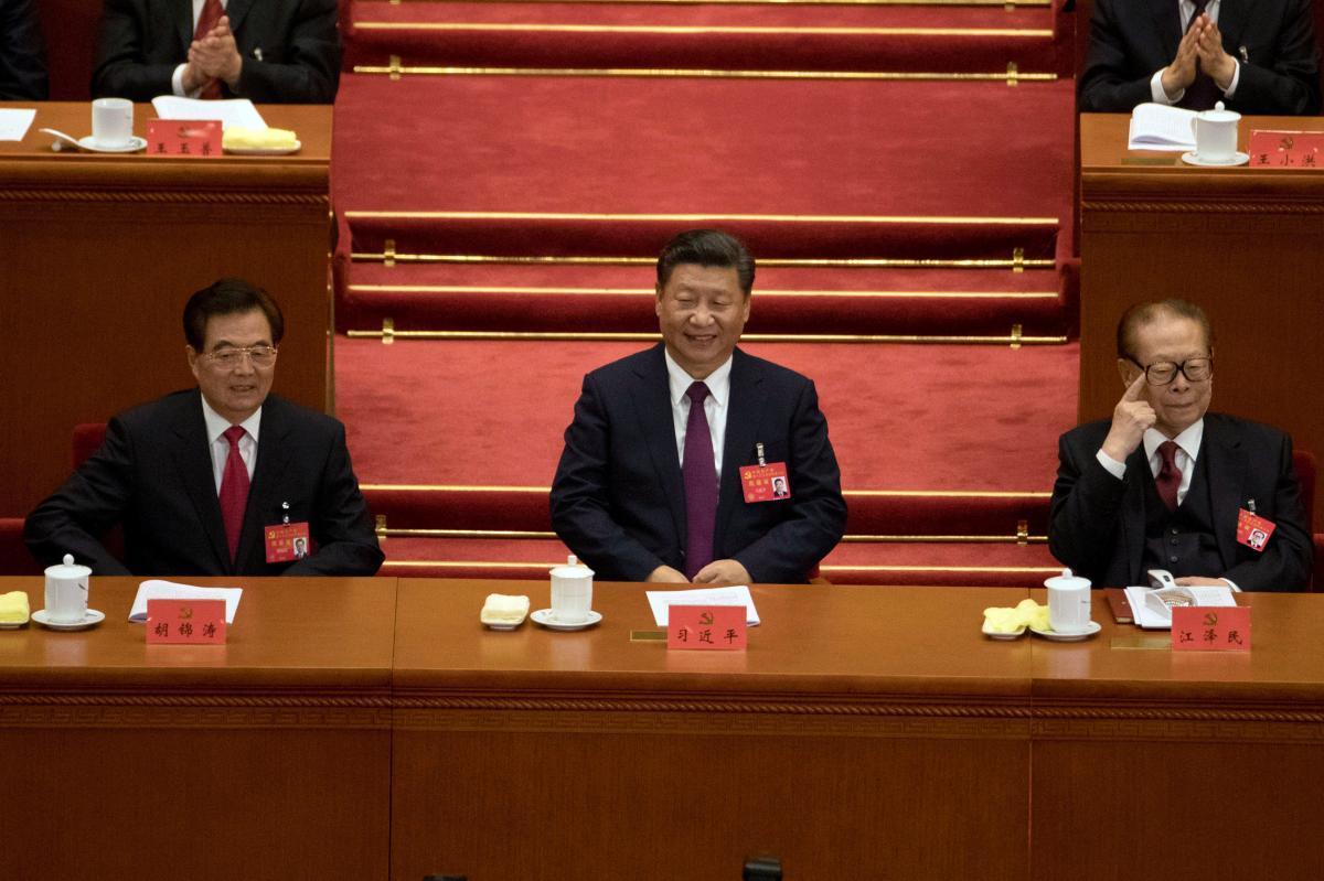 Chinese leader Xi Jinping, sitting between his predecessors Hu Jintao (left) and Jiang Zemin. (File Photo)